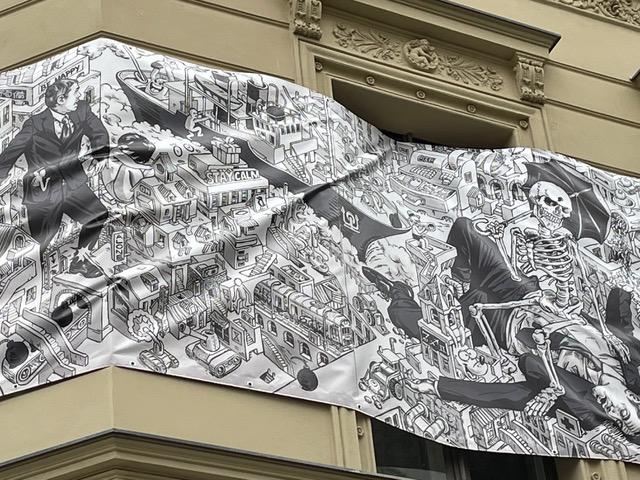 satirische Comiczeichnung Stadtleben an Hauswand